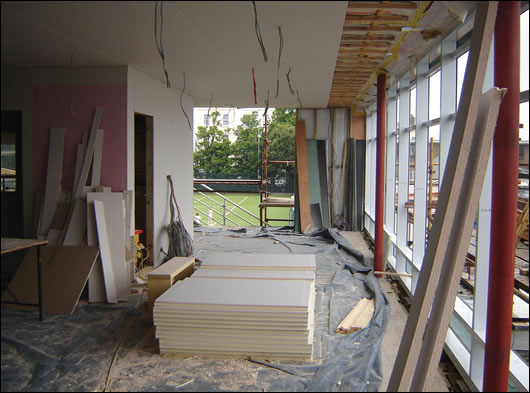 The curtain walling going up, and the ceiling showing insulated plasterboard, battening, and Siga Majpell membrane