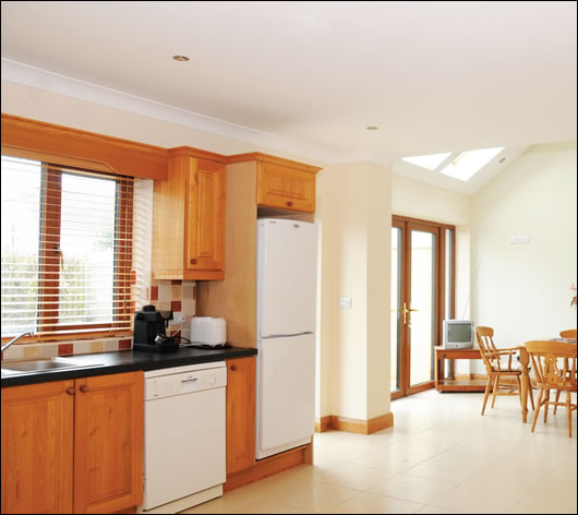 The kitchen was internally insulated and features an electric Velux roof window powered by a small solar PV panel