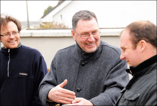 Homeowner Norman McMillan, centre, chatting with his son Doug, left, and builder Kevin Doyle of Doyson Construction