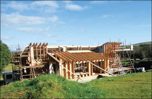The stick built timber frame structure