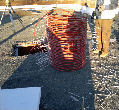 Coiled pipe for storing solar hot water in the Viking House floor slab