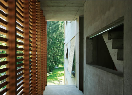 External wooden shades protect against overheating